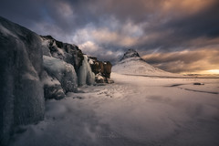 Classic view of the Kirkjufell (Manuel.Martin_72) Tags: iceland darkness drama enchanting lightdrama magic caves ice mountainpeaks mountainslope mountains rocks stones cascade frozen river snow water waterfall clouds glow morning sunrise kirkjufell