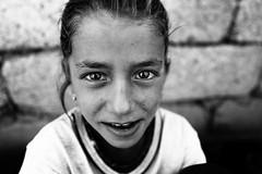 Soul of war (Giulio Magnifico) Tags: mosul desperate curiosity civilwar iraq leica macro portait soulful turkey destroyed smile naturallight refugeescamp detail eyes gaze child desert kurdish deepsoul iraqi iraqturchia middleeast future refugees leicaq blackandwhite streetlife italy 28mm isis kurdistan yazidi reportage littlegirl war
