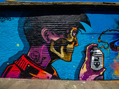 The Skull and Aerosols (Steve Taylor (Photography)) Tags: skull tattoo spray skeleton graffiti mural streetart roof contrast colourful aerosol man uk gb england greatbritain unitedkingdom london hand