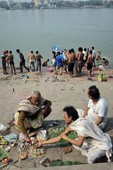 Life at the ghat (Rajib Singha) Tags: travel street people custom ghat river outdoor idol interestingness flickriver kolkata westbengal india