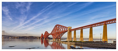 Late Afternoon Light at the Forth Bridges (theimagebusiness) Tags: theimagebusiness theimagebusinesscouk travel tourism touristattraction photographersinscotland photographersinwestlothian photography pretty attractive beauty bluesky vapour trails cloud forthbridge bridge railway scotland scottishweather riverforth colours clouds d810 edinburgh historic landscape momentintime naturallight nikon outdoors outside outdoor queensferry red sky sea uk visitscotland westlothian water winter