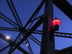 Burrard Street Bridge, north end (Reva G) Tags: bridge burrard girder metal burrardstreet vancouver downtown falsecreek lighting streetlight burrardbridge blue red bluehour evening architecture