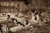 Little girl feeding geese. (K.Yemenjian Photography) Tags: littlegirl girl birds bird sepia river water beautifulgirl cherokee northcarolina cherokeenc feeding geese duck ducks beautyofnature nature lovely