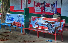 'Lifebuoy' waiting for the train (gerard eder) Tags: world travel reise viajes asia southeastasia birmania birma burma myanmar yangon trailwaystation people peopleoftheworld städte street stadtlandschaft streetlife streetart city ciudades cityscape cityview outdoor advertising bench