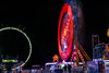 one man zipper (pbo31) Tags: bayarea california nikon d810 color march winter 2018 boury pbo31 fair rides midway spinning oakland night dark black butlar amuesments eastbay alamedacounty traveling carnival 66th lightstream motion lights zipper red loop cliffhanger ringoffire