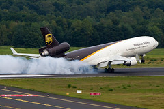 N282UP, McDonnell Douglas MD-11F, UPS is smashing on the runway @ Cologne/Bonn (freekblokzijl) Tags: cologne ups cargo summer smash landing touchdown rough tarmac runway germany cgn mcdonnel douglas md11 freighter konradadenauer airport smoke tires hardlanding deutschland vliegtuigspotten planespotting terrace canon eos7d 70200l28isusm afternoon sunday rubber