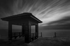 Long exposure of the pier in Bang Poo, Bangkok, Thailand (jonasfj) Tags: nikond750 50mm normallens nikkor 5014d bangpoo bangkok thailand asia southeastasia longexposure pier jetty concrete house hut clouds ocean water gulfofthailand sea afternoon sunset sky