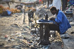 Working on the street in Debark, Ethiopia (Neal J.Wilson) Tags: africa ethiopia african workers working sewing debark streetscenes streetlife sewingmachine travel travelling centralafrica nikon