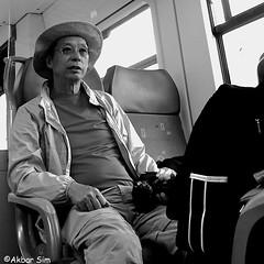 P1340221 (Akbar Simonse) Tags: holland netherlands nederland ns openbaarvervoer publictransport train trein people man candid toerist tourist camera hat hoed streetphotography straatfotografie vierkant squareformat zwartwit bw blancoynegro bn monochrome akbarsimonse