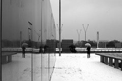 The man with the transparent umbrella (pascalcolin1) Tags: paris13 bnf homme man parapluie umbrella transparent neige snow mur wall reflets reflection photoderue streetview urbanarte noiretblanc blackandwhite 50mm canon50mm canon