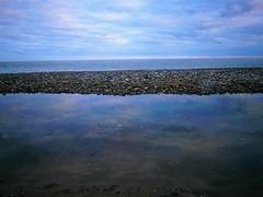 Blue Lagoon (Kinsella Media) Tags: water sea beach pool pond stones pebbles rocks seaside shore shoreline seascape coastal coast nature outdoors adventure rambler naturephotography reflection evening arklow ireland eire wicklow leinster discoverireland blue horizon marine irish