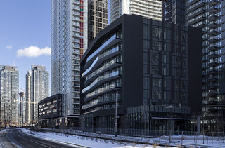 20171215. The black-clad Exchange Condominiums, surrounded by the skyscraping towers of Concord CityPlace.