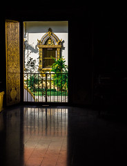 Light Outside The Temple (aritzduran_) Tags: thailand chiangmai temple monk buda buddhism culture lensculture colour calle35 streetphotogrephyinternational streetphotographer street tradition pray 25mm travel window lights darkness shadow reflection