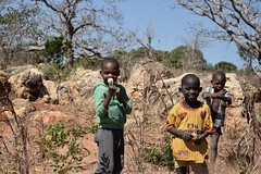 A Story..... (The Spirit of the World ( On and Off)) Tags: boys children playing hunting countryside mozambique remote macua quirinthepeninsula africa eastafrica baobabtrees trees rocks smiles locals candid