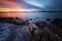 Oslofjorden (eriknst) Tags: sunset sea water sky rock ocean bay oslo nikon d810 longexposure lee sirui fjord clouds sun blue pink orange purple wide angle frost