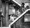 Brew time (Mick Steff) Tags: tea cup talking people male female fire escape stairs black white mono monochrome smoking smoke break brew architecture