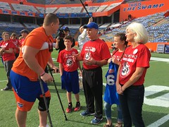 2016_T4T_University of Florida 96 (TAPSOrg) Tags: taps tragedyassistanceprogramsforsurvivors teams4taps gainesville florida universityofflorida football collegefootball salutingthosewhoserve survivors 2016 military horizontal redshirt footballfield player group family candid male woman teen boy kid child outdoor
