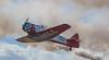 Low Pass Stunt Plane (tclaud2002) Tags: plane airplane aircraft aviation stuntplane airshow clouds smoke low lowpass stuart florida usa cockpit