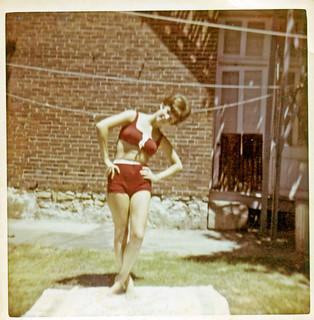 Woman in Swimsuit Posing in Backyard, 1960s