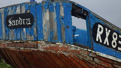 A Fave Subject in a Fave Place of Mine - 7 (catchesthelight) Tags: colorful workingboats seaside eastsussex hastingsuk travel boats maritimeshore rust peelingpaint fishingboats hastingsengland englishchannel shingle