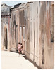 Friends Through History (The Spirit of the World ( On and Off)) Tags: children locals playing deserted unescoworldheitagesite warehouses homes street road shadows historical ilhademocambique island indianocean africa eastafrica candid