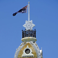 HAPPY HOLIDAYS 2017 from AUSTRALIA . MELBOURNE   (#128 in series) - 27Nov2014 sRGB web (JAYKAY144) Tags: melbourneau collingwood collingwoodcityhall historic cupola star flag sky spring bluesky cheerful warm wroughtironfence rooftiles dome window circularwindow