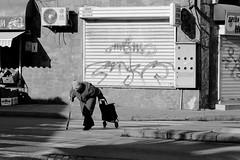 Passage (ZUHMHA) Tags: bulgarie bulgaria winter hiver kazanlak urban urbain street rue people personnes gens human humain letter lettre ot word sign texte text écriture sun soleil ombre lumière light ombreetlumière silhouette monochrome