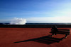 La mareggiata (meghimeg) Tags: 2017 sanremo mareggiata mare sea panchina bench uomo man ombra shadow sole sun schiuma onda wave rosso red rot royo cielo sky storm