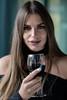 A taste of ...  wine (piotr_szymanek) Tags: kornelia portrait studio wine longhair woman smile hand eyesoncamera young arms 5k 50f 10k 20k