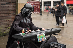 """Always look on the DARK side of life."" (Mister Oy) Tags: davegreen oyphotos ©oyphotos darthvader busker starwars character street fujix100f movie streetphotography black keyboard musician comedy fun humour humor manchester piccadilly"