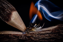 Two Sticks And Fire By Friction (Mark Wasteney) Tags: macromondays stick sticks wood fire smoke closeup upclose macro textures flash backlit backlighting action friction heat
