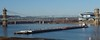 Ohio River Tow makes 90 degree turn (durand clark) Tags: roeblingbridge covingtonkentucky cincinnatiohio ohioriver newportkentucky ashlandoil marathonoil barge mcginnisbargelines olympusem1 lickingriver confluence