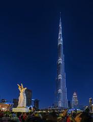 Tallest! (Abhi_arch2001) Tags: tallest tall tower world skyscraper burj khalifa dubai united arab emirates uae glow light blue hour hand gesture symbol sign sculpture building skyline led downtown park