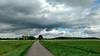 Passing storm (andzwe) Tags: storm passing netherlands dutch passerendestorm weiland meadow sunlight zon panasonicdmcgh4 clouds sky mobilephone smartphone motoxstyle motorola