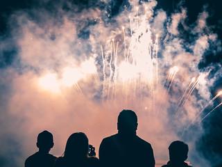 family under fireworks