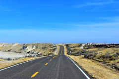No traffic out here (thomasgorman1) Tags: highway desert barren remote lines bluesky nikon nm dip curver curved rural empty