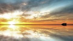 One To Warm Your Soul (PhotonenBlende) Tags: australia westernaustralia australien westaustralien ray strahlen sunset sonnenuntergang sky himmel reflections reflektion horizon horizont sun sonne island insel rock fels coast küste warm colourful farbenfroh landscape landschaft skyscape surreal illusion fineart kunst hdr nikon d50 tamronsp outdoor