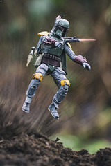 Up Up and Away (jezbags) Tags: boba fett flying action bobafett starwars toy toys actionfigure bounty hunter canon canon80d 80d 100mm macro macrophotography macrodreams dirt explosion