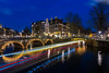 Amsterdam (Enrique EKOGA) Tags: dutch architecture amsterdam holland city bluesky bluehour lights water dark boat nikon longexposure travel buildings bridge night d800e lighttrails jordaan keizersgracht netherlands