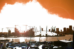 Welcome to the Thunderdome (Steve Taylor (Photography)) Tags: welcometothethunderdome art architecture digital building crane brown blue black contrast white texture lensflare cloud sunny sun millenniumdome sunshine thames river greenwich o2 dystopian dystopia