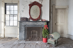 The Photographer's House (Jonnie Lynn Lace) Tags: abandoned abandonedamerica house home christmas 2017 red white fireplace mirror door doors peelingpaint chair yellow green old architecture classic interior indoors inside room relic tree christmastree nikkor nikon d750 shadows light day daylight usa unitedstates urbex exploration explore texture textures derelict decay detail details bow holiday december winter cold colours colorful digital flickr ny 24mm rockingchair wood window