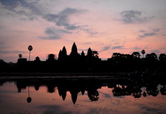 Beautiful sunrise at Angkor Wat ancient temple, Siem Reap, Cambodia (Germán Vogel) Tags: asia southeastasia cambodia siemreap angkorwat buddhism hinduism temple buddhisttemple hindutemple waterreflection sunrise sky silhouette travel traveldestinations traveltourism tourism touristattraction landmark holidaydestination famousplace unescoworldheritagesite ancient ancienttemple ruins tropical indochina khmerempire khmerculture cambodianculture buddhistempire hinduempire
