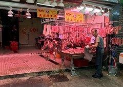 Local Butcher (cowyeow) Tags: central man worker meat butcher pig pork china chinese asia hongkong kowloon food urban gross street