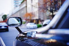 Wing mirror focus (Eric Flexyourhead) Tags: nagatacho 永田町 chiyoda chiyodaku 千代田区 tokyo 東京 japan 日本 city urban detail fragment car japanese taxi cab taxicab mirror rearviewmirror wingmirror shallowdepthoffield bokehlicious bokeh sonyalphaa7 zeisssonnartfe55mmf18za zeiss 55mmf18