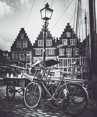 The favourite means of transportation for the Dutchman... (DST-photography) Tags: hoorn walk bw black white monochrome dramatic hdr sigma 1750mm nikon d7100 city centre christmas westfriesland lowlands netherlands holland amsterdam clouds weather toren tower hoofdtoren port haven boat people tree sky road building park architecture