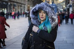 Blue and Green (Leanne Boulton) Tags: portrait urban street candid portraiture streetphotography candidstreetphotography candidportrait streetportrait streetlife woman female girl face expression eyes look emotion feeling mood atmosphere green blue hair cosmic fur hood winter tone texture detail depthoffield bokeh naturallight outdoor light shade shadow city scene human life living humanity society culture people fashion style canon canon5d 5dmarkiii 70mm ef2470mmf28liiusm color colour glasgow scotland uk