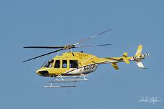 Santa Pilots His Helicopter (dcstep) Tags: dsc0453dxo sonya7riii fe100400mmf4556gmoss cherrycreekstatepark colorado usa aurora allrightsreserved copyright2017davidcstephens dxophotolab santa helicopter yellow blue captureone