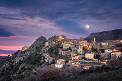 Full moon over Balagne village of Speloncato in Corsica (joningall) Tags: corse france corsica arch sunset church nature maquis evening bell door blue tile balcony tower roof terrace mountain ancient rock speloncatu window purple moon winter orange entrance dusk speloncato balagne village stone cloud sky light crag house hill supermoon old natural europe hautecorse dramatic