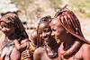 The Smile (gecko47) Tags: group women baby himba ethnicminority kaokoland seminomadic village traditionallife cattleherders namibia arid dof explore ochrepowderfat headdresses jewellery