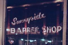 Sunnyside Barber Shop - img572 (T. Brian Hager) Tags: minoltax700 minolta x700 film analog 35mm color roanokeva sign fuji fujicolor 400 superia fujicolorsuperiaxtra400 window flag americanflag